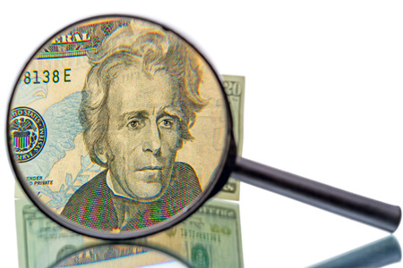 increased: Andrew Jackson in front of the twenty dollar banknote  increased magnifier