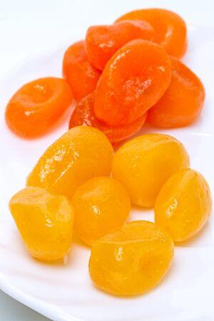 cumquat: Dry yellow and orange cumquat on a white plate