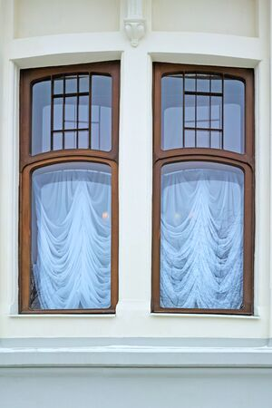 dual: Architectural detail - dual window in classic style. Series - various windows Stock Photo