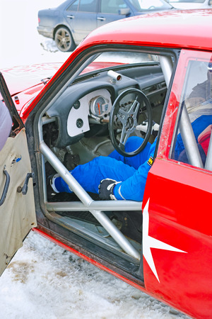 red sports car: The pilot of the interior of a red sports car Stock Photo