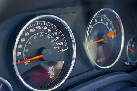kph: Closeup of dashboard on car. Speedometer and LED door open Stock Photo