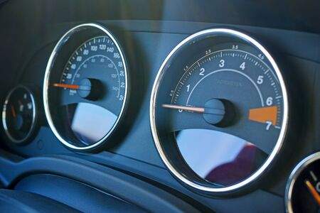tachometer: Close Up of dashboard and tachometer on car.