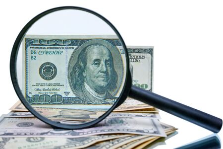 counterfeit: Example of a counterfeit 100 dollar bill increased magnifier