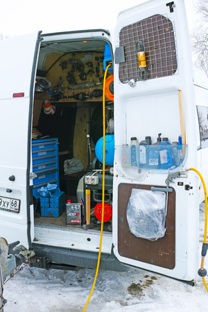 Tambov, Russia - February 21, 2015: Winter car track races on the Cup of the Tambov region. Interior of mobile service van with tools. The quality of medium format
