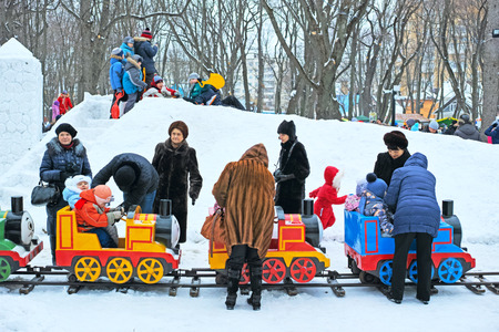 pancake week: Tambov, Russia - February 15, 2015: Maslenitsa (pancake week, shrovetide) - carnival of farewell winter and meeting spring in Tambov.  Attraction - Children train.  The quality of medium format