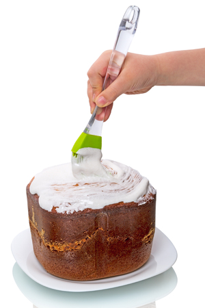 Child preparing cake isolated on a white background