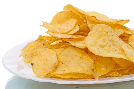 broiling: Fried potatoes on a white plate, homemade potato chips
