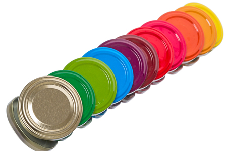 lids: Multicolored metal lids for glass jars isolated on white background