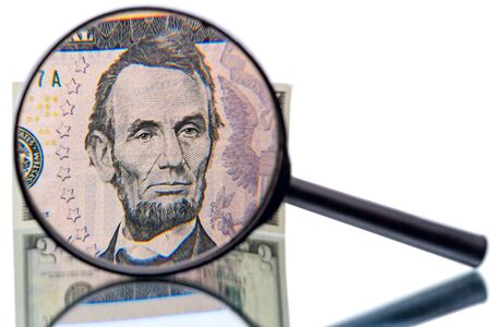 increased: Abraham Lincoln  in front of the  five  dollar banknote  increased magnifier