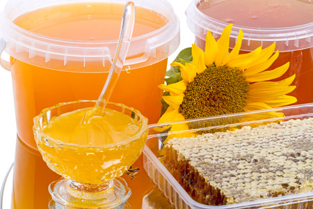 honey comb: Honey in the comb,  sunflower and different varieties of honey