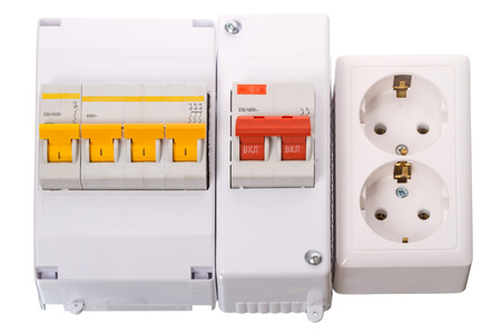 amperage: Circuit breakers and double electric socket isolated on a white background.  Stock Photo