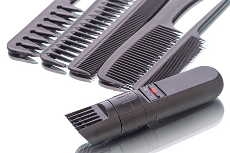 clipper: Portable hair clipper with zoom trimmer and  black combs  isolated on a white background