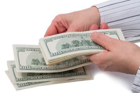 bankroll: Female hand feel 100 dollar bills Isolated on white background Stock Photo