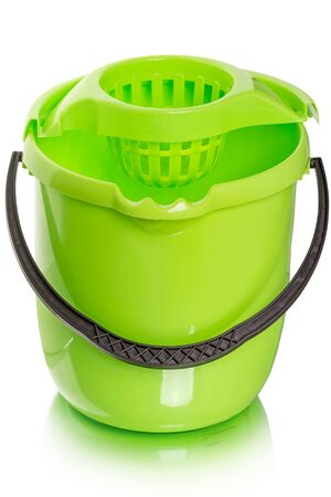 Green  plastic bucket for wet cleaning  isolated on a white background