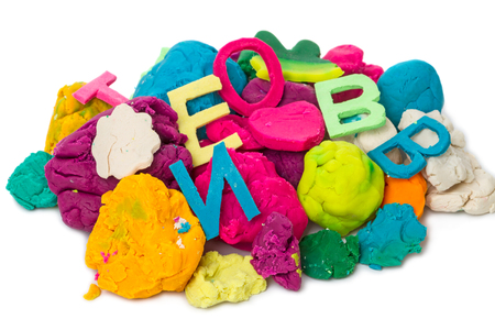 modeling: A pile of waste modeling clay Isolated on white background