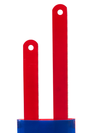 saw blade: Two red spare saw blade in the package isolated on a white background