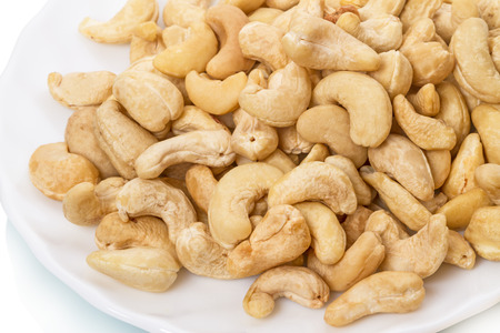 palate: Cashews tender and succulent on the palate on a white plate