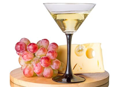 cocteles: Martini cocktail in a  glass with grapes and cheese isolated on a white background Foto de archivo