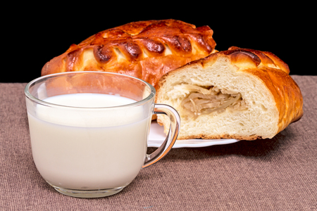 edibles: Pie (Kulebyaka) with cabbage and  a cup of milk