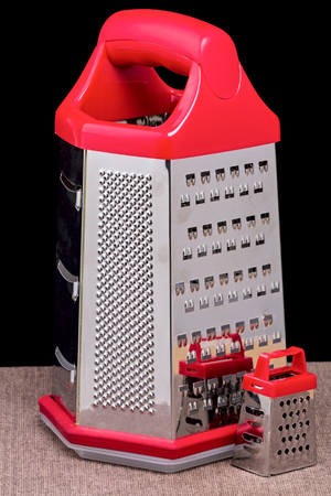 grater: Large and small kitchen grater on a black background Stock Photo