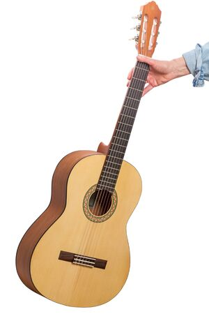 bard: Classical six-string guitar in hand isolated on white background Stock Photo