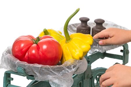 weigher: The old mechanical scales with vegetables isolated on white background Stock Photo