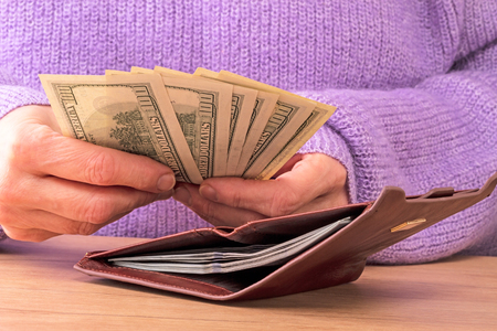 considers: A woman in a lavender sweater considers Dollars