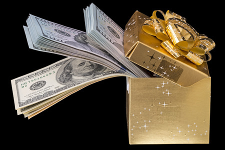 christmas savings: Christmas box with dollars isolated on a black background Stock Photo