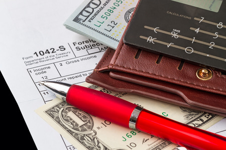 confirms: Income and taxes - filling out the form 1042-s which confirms the payment of the tax in the United States Stock Photo
