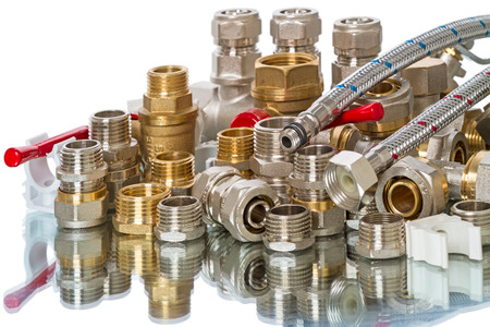 collet: Pile of plumbing parts isolated on white background with reflection Stock Photo