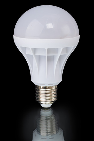 e27: Electric LED lamp with an E27 base isolated on a black background