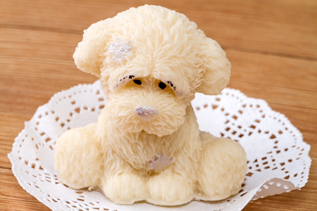 primarily: Cake of marzipan in the form of a puppy. Marzipan is a confection consisting primarily of sugar or honey and almond meal Stock Photo