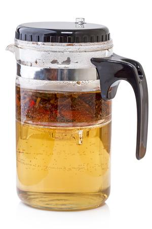 non alcoholic: Glass teapot with tea isolated on white background Stock Photo