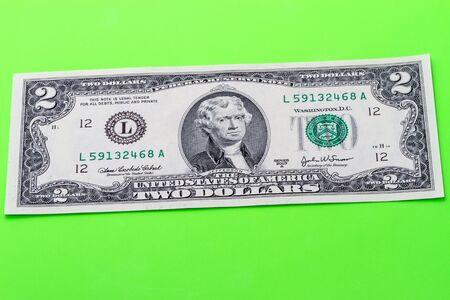 denomination: The denomination is two dollars on a green background. Side view