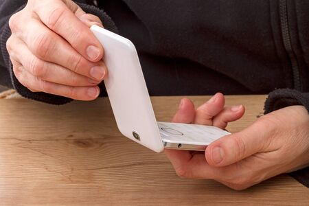 vibrate: Open clamshell mobile phone in hand Stock Photo