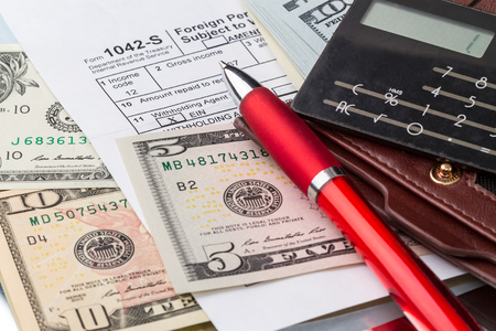 taxes: Income and taxes - filling out the form 1042-s which confirms the payment of the tax in the United States Stock Photo