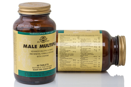 lycopene: Tambov, Russia - March 7, 2016: Two jars Solgar Male Multiple Tablets on a white background. Male Multiple Tablets is one of Solgars premium-quality mens health products. Solgar has been innovating and producing fine quality nutritional supplements sinc