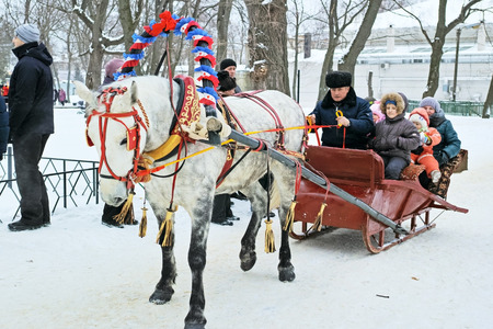 pancake week: Tambov, Russia - February 15, 2015: Maslenitsa (pancake week, shrovetide) - carnival of farewell winter and meeting spring in Tambov.  Attraction - Russian Riding in a sleigh.  The quality of medium format