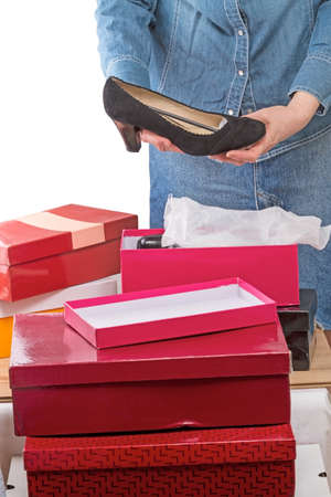 shoe boxes: Woman with black shoes and shoe boxes