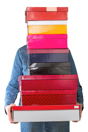 shoe boxes: Woman with shoe boxes isolated on white background Stock Photo