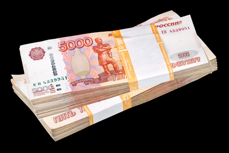 money packs: Two packs of Russian paper money 5000 rubles isolated on a black background