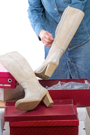 shoe boxes: Woman with winter boots and shoe boxes