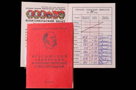 social history: Komsomol membership card isolated on a black background Stock Photo
