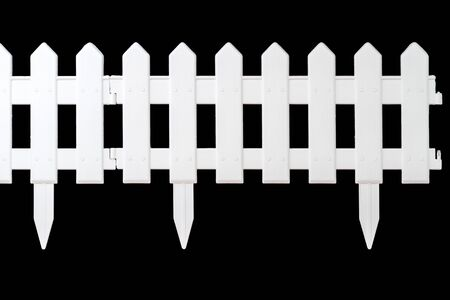 paling: Plastic fence for flowerbeds isolated on a black background Stock Photo