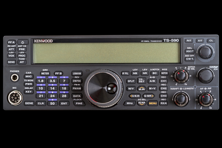 hf: Tambov, Russia - June 18, 2016: The transceiver Kenwood TS-590 view from the front isolated on a black background. The transceiver Kenwood TS-590, operates on the HF + 50 MHz with all modulation modes with two-channel receiver
