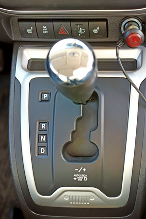reversing: Automatic gear shifter with center console of a car view from the top