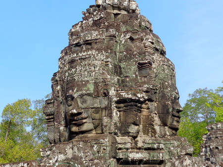 smiling buddha: Smiling Buddha faces at Bayon temple tower in Cambodia