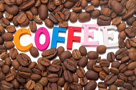 single word: Background from coffee beans and Single word Stock Photo