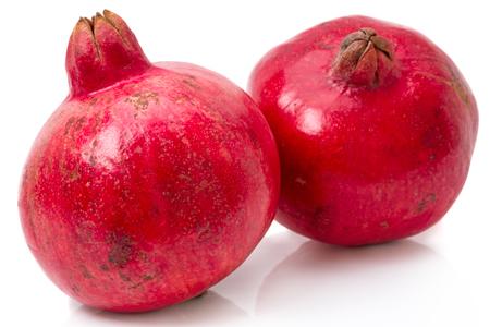 garnets: Two ripe pomegranate isolated on white background Stock Photo