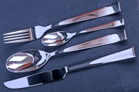 eating utensils: Four subjects Eating utensils on a black fabric